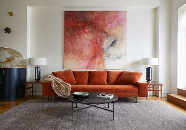 the-irving-sofa-by-verzelloni-sits-between-vintage-scandinavian-rosewood-end-tables-with-interior-pull-out-trays-the-large-abstract-artwork-is-a-1970s-oil-painting-by-unknown